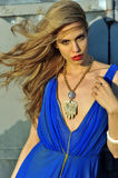 Closeup portrait of fashion model with full hair and red lips Royalty Free Stock Images