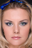Closeup portrait of fashion woman with blue bow Royalty Free Stock Photos