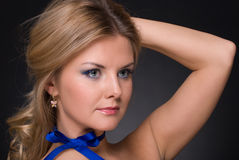 Closeup portrait of fashion woman with blue bow Stock Photography