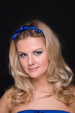 Closeup portrait of fashion woman with blue bow Stock Images