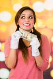 Closeup portrait of female clown mime holding a twenty dollar bill. Asking for money Stock Images