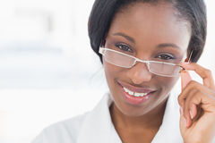 Closeup portrait of a female doctor with eye glasses royalty free stock image