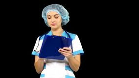 Closeup portrait of a female doctor writing on stock footage