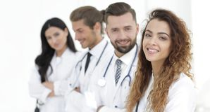 Portrait of female doctors with colleagues. Closeup.portrait of female doctors with colleagues stock photo