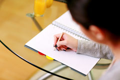 Closeup portrait of a female hand writing notes Royalty Free Stock Images
