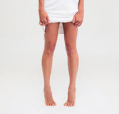 Closeup portrait of female legs with towel Royalty Free Stock Photos