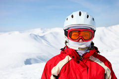 Closeup portrait of a female skier. Standing on a ski slope Royalty Free Stock Images