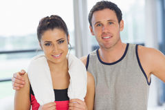Closeup portrait of a fit couple in exercise room Royalty Free Stock Image