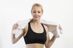 Closeup portrait of fit mature woman with a towel. Stock Photos