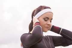 Closeup Portrait of Fitness Caucasian Woman Listening to Music d Stock Images