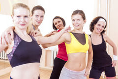 Closeup Portrait of Five Happy Caucasian Female Athletes Posing Together Embraced Against Fitballs Royalty Free Stock Photos