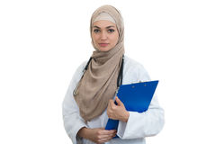 Closeup portrait of friendly, smiling confident muslim female doctor holding folder. Royalty Free Stock Photo