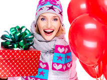 Closeup portrait of fun happy adult woman with red gift box and Royalty Free Stock Photography