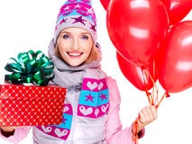 Closeup portrait of fun happy adult woman with red gift box and Stock Photos