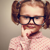 Closeup portrait of fun happy  kid girl in glasses Royalty Free Stock Photo