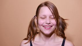 Closeup portrait of a funny attractive laughing teen girl. 4K UHD stock video