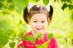 Closeup portrait of funny little kid. beautiful girls face happy Stock Images