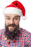 Closeup portrait of a funny man with colorful Christmas balls in Stock Photos