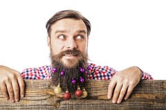 Closeup portrait of a funny man with decoration balls in his bea Stock Photo