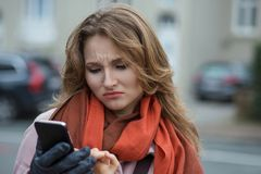 Funny sad woman looking up thinking seeing bad news sms comment royalty free stock image