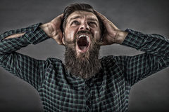 Closeup portrait of a furious young man yelling Stock Images
