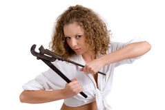 Closeup portrait of girl with big wrench Royalty Free Stock Image
