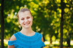 Closeup Portrait Of Girl In Blue Knitted Dress Royalty Free Stock Photos