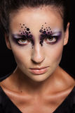 Closeup portrait of girl with creative makeup Stock Photos