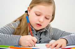 Portrait of girl drawing with colorful pencils. Closeup portrait of  girl drawing with colorful pencil Royalty Free Stock Photos