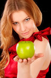 Closeup portrait of girl with green apple Royalty Free Stock Image