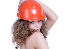 Closeup portrait of girl in orange helmet. Closeup portrait of beautiful curly girl in orange helmet Royalty Free Stock Photos