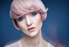 Closeup portrait of a girl with a pink haircut Royalty Free Stock Image