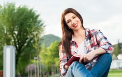 Closeup portrait of girl relaxing outdoor and writing on journal Stock Photo