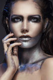 Closeup portrait of girl with silver makeup Stock Photos