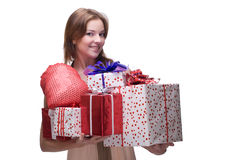 Closeup portrait of girl with some gifts. Closeup portrait of beautiful girl with green eyes, clear makeup and some gifts Stock Photography