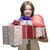 Closeup portrait of girl with some gifts. Beautiful woman with clear makeup and some gifts box Stock Photo