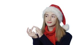 Girl in Santa hat counting fingers stock video