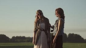 Closeup portrait of girlfriends at dawn. two young girls in hippie clothes posing for the camera and smiling