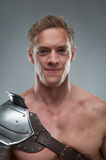 Closeup portrait of Gladiator in armour over grey royalty free stock photos