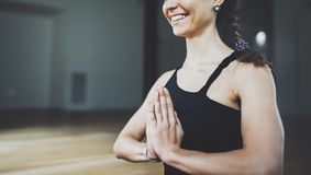 Closeup portrait of gorgeous young woman practicing yoga indoor. Beautiful girl practice meditation asana in class Royalty Free Stock Images