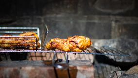 Closeup portrait of grilled chicken leg in natural coal grill stock images