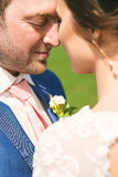 Closeup portrait of groom with closed eyes with bride Stock Photo