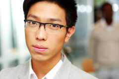 Closeup portrait of a handsome asian man Royalty Free Stock Images
