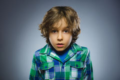 Closeup Portrait of handsome boy with astonished expression on grey background Stock Photo