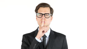 Closeup portrait handsome, businessman , finger on the lips. sign for silence Royalty Free Stock Photography