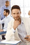 Closeup portrait of handsome businessman. Closeup portrait of handsome young businessman looking at camera, smiling Royalty Free Stock Image