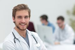 Closeup.portrait of a handsome doctor. On blurred background office stock photo