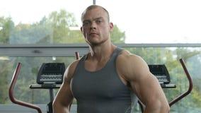 Closeup portrait of a handsome man at gym