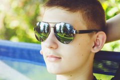 Closeup portrait of handsome man in stylish black sunglasses. Royalty Free Stock Images