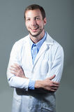 Closeup portrait of handsome young doctor crossing Stock Image